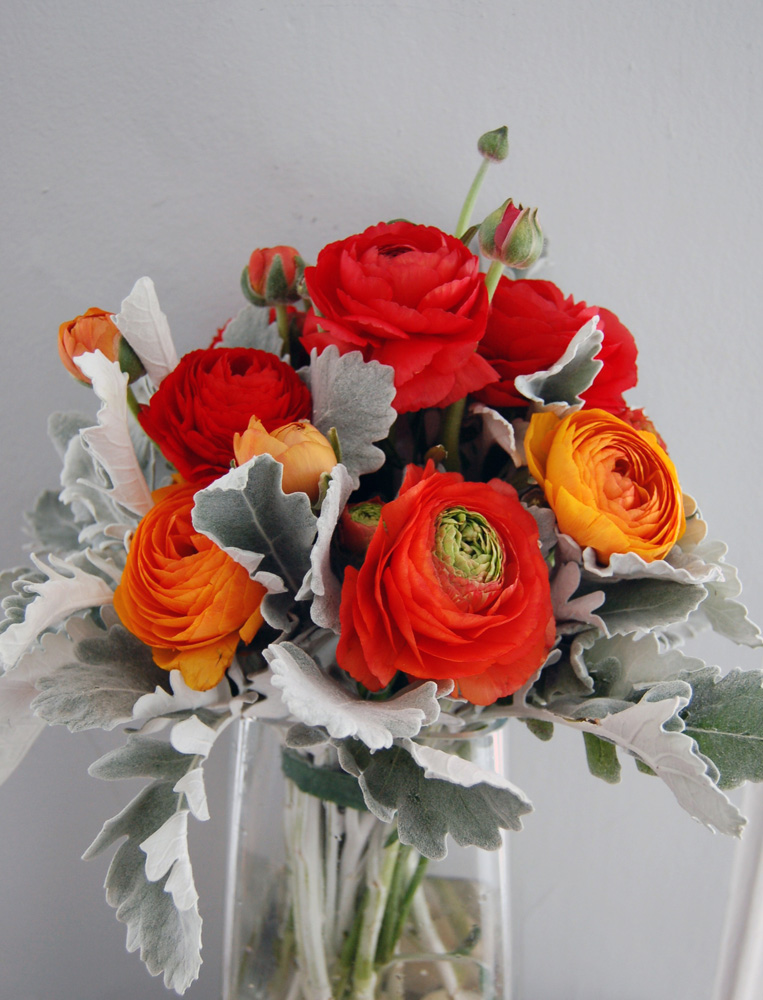 bright red ranunculus, orange ranunculus, bright bouquet, red, orange, grey